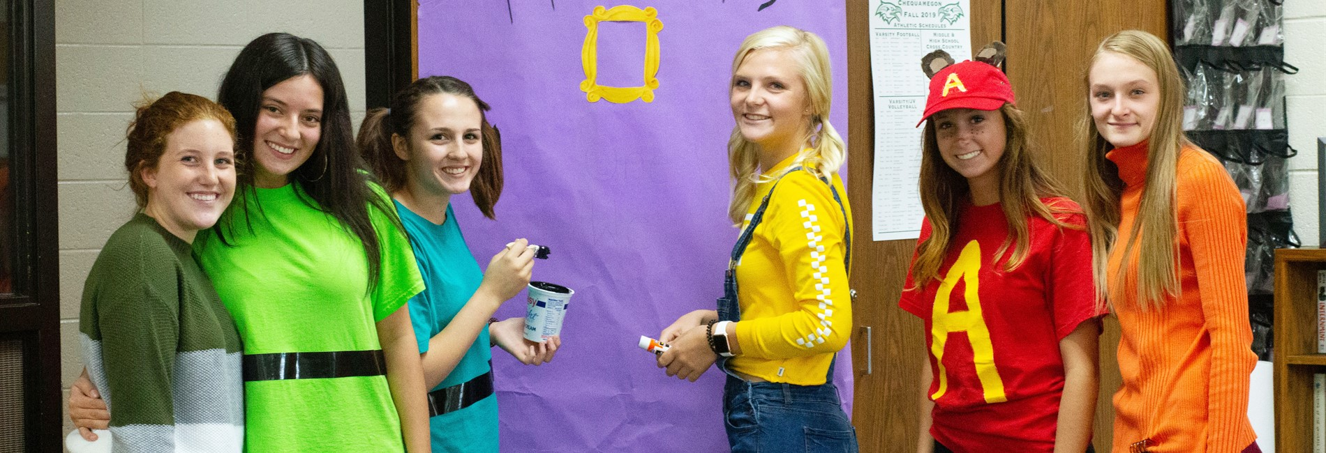 Senior class members working on their door banner for Homecoming