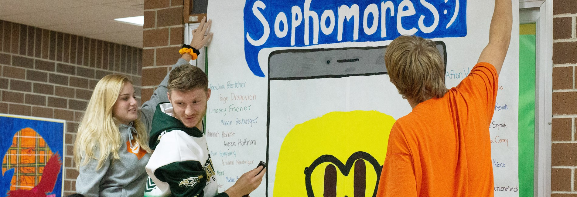 Sophomores hanging their class banner for Homecoming