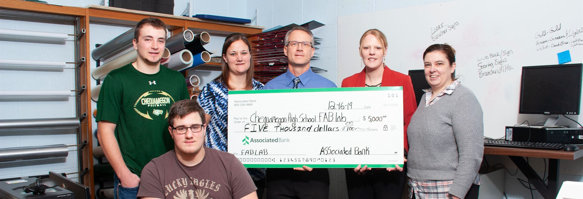 The Chequamegon STEAM Class receives a grant from Associated Bank.